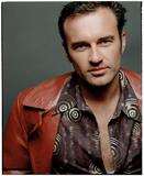 http://img149.imagevenue.com/loc462/th_88624_celebrity_city_Julian_McMahon_10_123_462lo.jpg